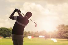 Man Hitting Golf Shot With Clu...