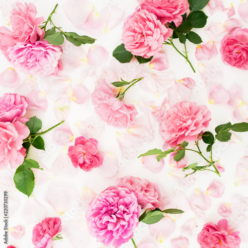 Foto op Canvas Bloemen Floral composition of pink rose flowers on white background. Flat lay, Top view. Flowers texture.