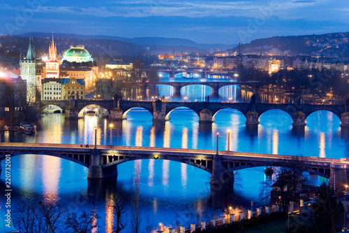 Poster Prague Prague bridges and Moldau river from Letna orchards, Lesser Town, Prague, Czech republuc. Night view.