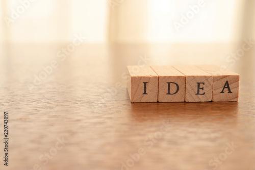 Fotografia, Obraz  Wooden Text Block of Idea