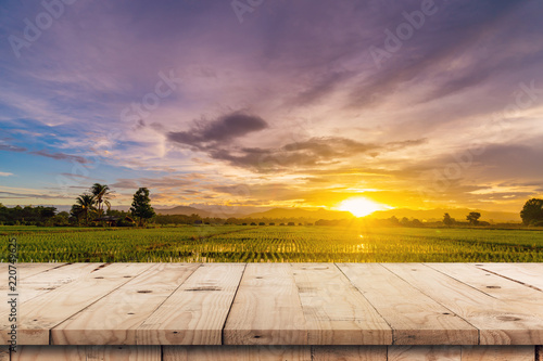 Keuken foto achterwand Lavendel Rice field sunset and Empty wood table for product display and montage.