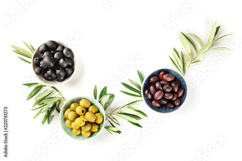 Overhead photo of various olives in bowls on white with copy space