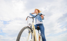 Girl Rides Bike Sky Background...