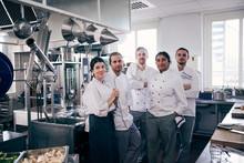 Portrait Of Five Chefs In Kitc...