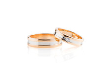 Rose Gold And White Gold Wedding Rings Isolated On White Background