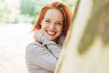 Cute Vivacious Redhead Woman With Beaming Smile