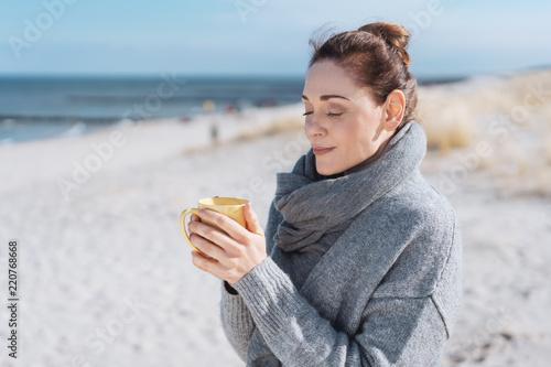 Fotografia, Obraz Young woman enjoying a relaxing cup of coffee