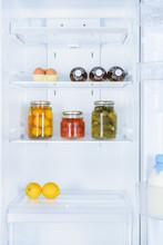Lemons, Preserved Vegetables And Eggs In Fridge