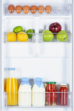 Apples, Lemons, Juice And Milk In Fridge