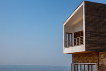 Side View Of One Modern Penthouse Apartmen With Large Balcony. Blue Sky And Horizon In The Background.