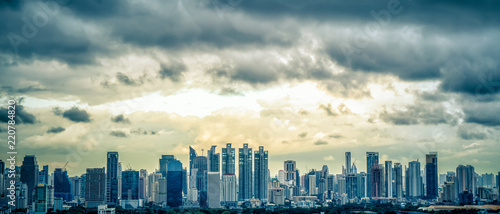 Spoed Fotobehang Milan Panorama landscape scenery of buildings and skyscrapers in business center of Bangko city with rainy cloud over city in blue tone