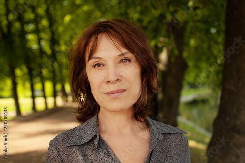 Fotografie, Obraz  Perfect mature woman face. Mid adult lady outdoors