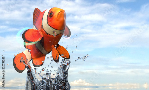 Fototapeta Clownfish anemone fish close up photo in air with splash