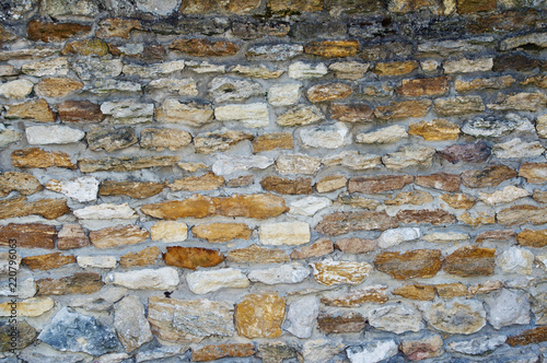 Texture of an old stone wall. Closeup