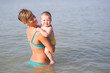 Mom with a baby on the sea