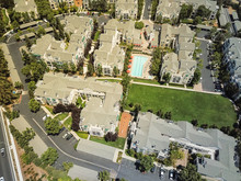 Aerial View Typical Multi-level Apartment Homes With Swimming Pool In Silicon Valley, California