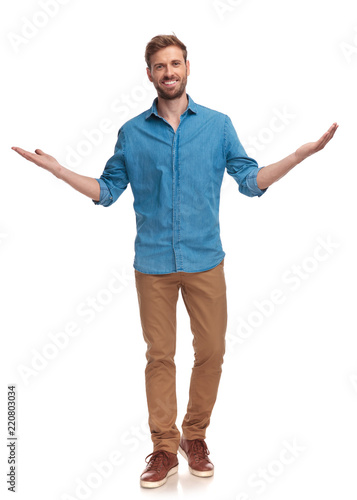 Obraz happy casual man welcoming on white background - fototapety do salonu