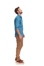 Side View Of A Casual Man Looking Up At Something
