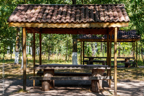 Groovy Picnic Site In Park Wooden Table And Benches In Green Ibusinesslaw Wood Chair Design Ideas Ibusinesslaworg