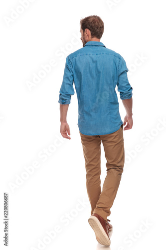 Fotografie, Obraz  back view of  casual man walking and looking to side
