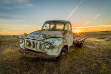 Old Rusty Car In A Field In Australia With Sunset In The Background