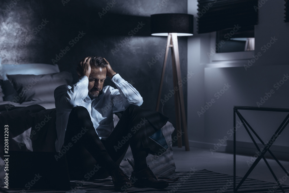 Fototapeta Depressed man alone at home