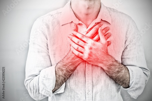 Stampa su Tela Composite image of mid section of a man with chest pain