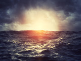 Sunset on stormy sea