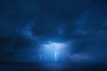 Summer Storm, Dramatic Sky  And Amazing Lightnings Over The Ocean. Natural Background