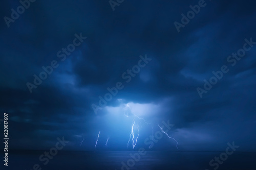 Poster de jardin Tempete Summer storm, dramatic sky and amazing lightnings over the ocean. natural background