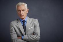 Confident Senior Business Man, Studio Portrait
