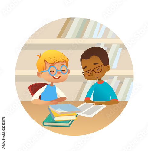 Foto  Smiling multiracial boys reading books and talking to each other at school library