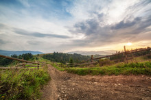 Old Wooden Fence, Rural Road And  Top Of Mountain On Horizon On Sunset. Summer (autumn) Landscape