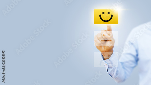 Hand of client show a feedback with smiley face card Fototapet