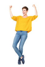 Full Length Happy Young Woman With Short Hair Cheering And Punching The Air