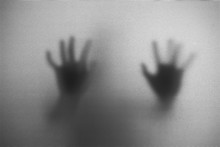 Shadow Of Man On The White Frosted Glass