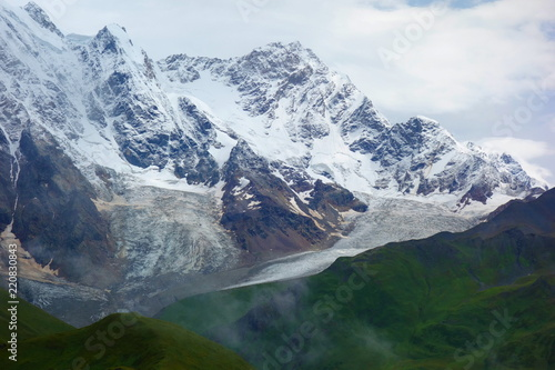 Photo Stands Nepal Amazing mountain Caucasus landscape of peaks of mountains Tetnuldi, Gistola and Dzhangi-Tau and glacier Lardaad in Svaneti, Georgia. View on Snowy Rocky mountains and Adishi glacier