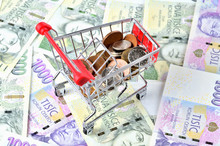Czech Coins In A Shopping Cart On Banknotes - Finance Concept