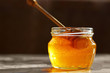 jar of honey of different colors with a wooden spoon