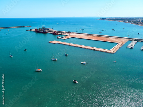 Tuinposter Poort Salt-loading berth in port of Torrevieja. Costa Blanca, Spain