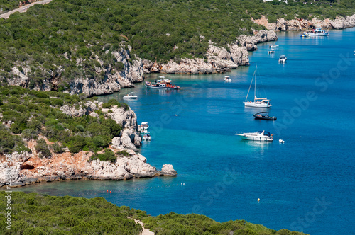 Landscape of sardinian coast with moored boats