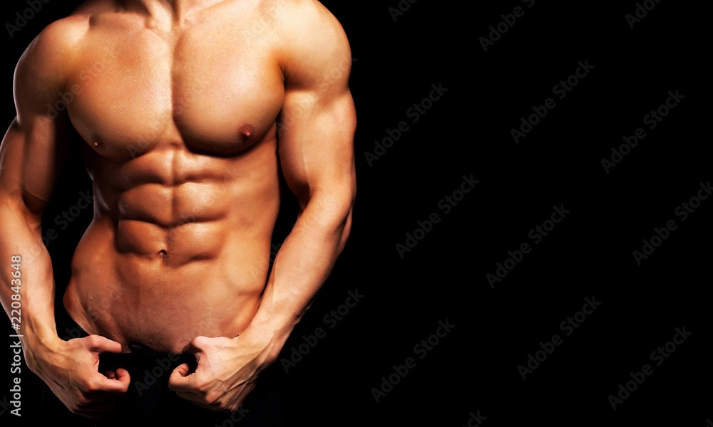 Fototapety, obrazy: Close up of perfect male body isolated on black background with