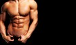 Close up of perfect male body isolated on black background with