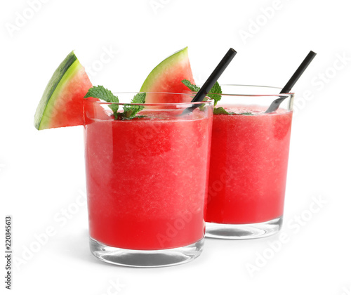 Tasty summer watermelon drink in glasses on white background