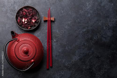Red tea pot and sushi chopsticks