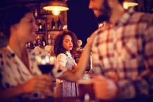 Jealous Woman Looking At Couple Flirting With Each Other