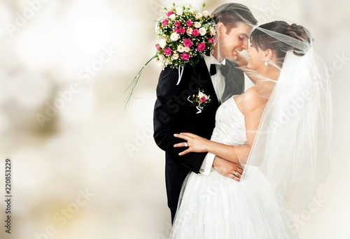 Fotografie, Obraz  Happy just married young couple  with flowers