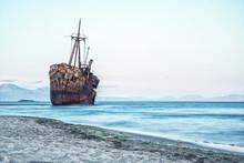Greek Coastline With The Famous Rusty Shipwreck In Glyfada Beach Near Gytheio, Gythio Laconia Peloponnese Greece.