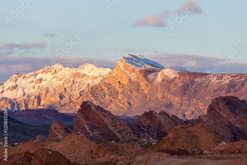 Foto op Canvas Cappuccino Sunset lights distant snow covered mountains