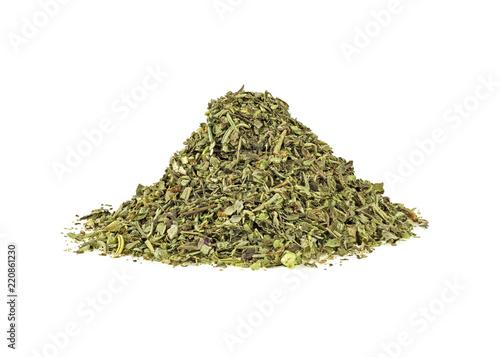 Fototapeta Mixed italian herb seasoning on a white background obraz